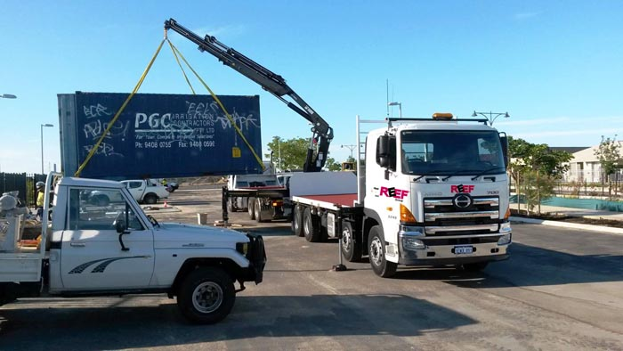 Image of the hiab crane truck delivering a sea container