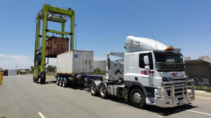 Transporting heavy load with trucks in Western Australia