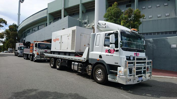 Tilt Tray moving large machinery out of Perth WA