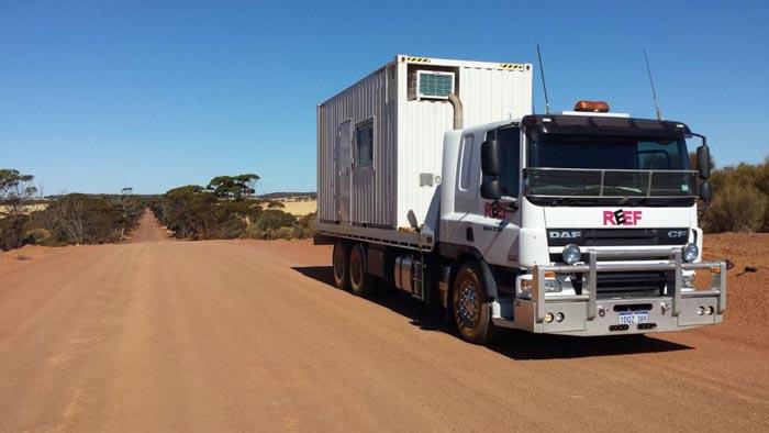 White Tilt Tray WA transporting large trailer