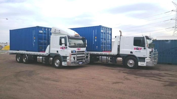 Two Tilt Tray Truck Transporting Sea Container in Perth WA