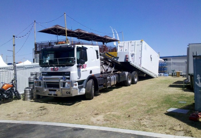 Image of tilt tray delivering a sea container for Fringe World