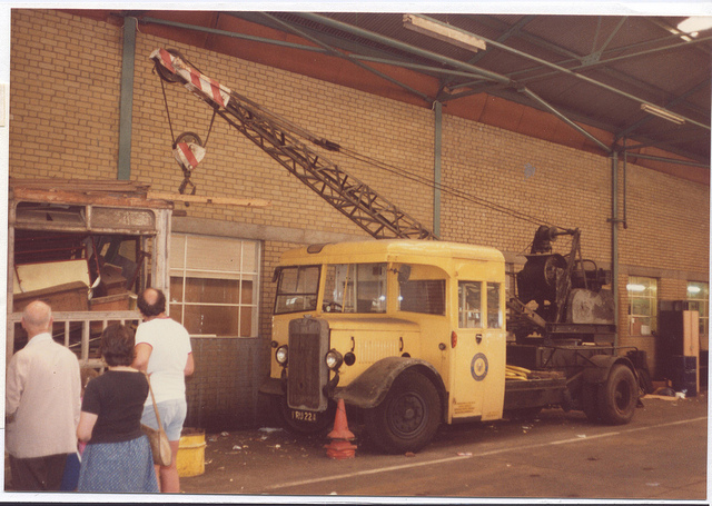 vintage photo of a hiab crane transporting items in the 80s